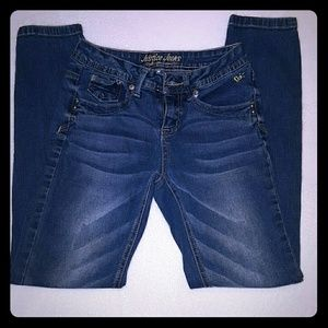Never worn stretchy skinny Justice jeans